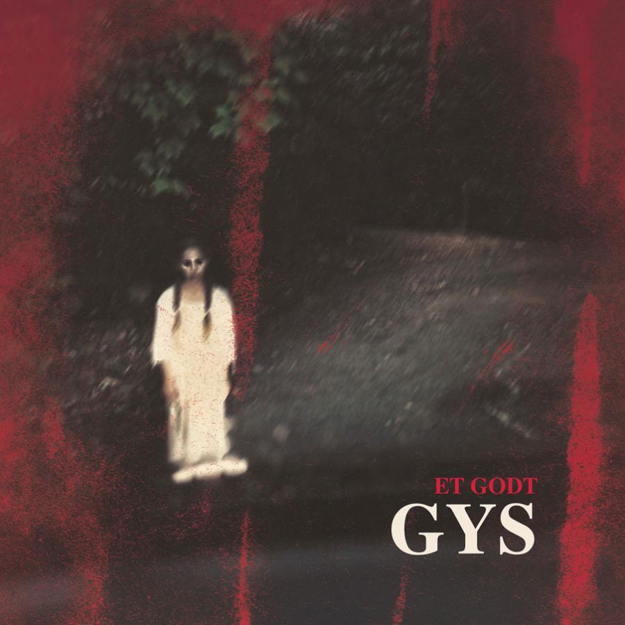 Et godt gys - uklart rødligt billede med pige i hvidt og store sorte øjne